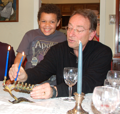 Michael and Cousin Alan Light the Menorah