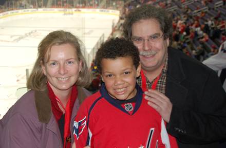 Leigh, Michael, and David at a Caps game