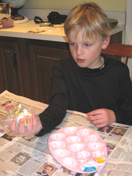 Carson rolls an egg in his dye.